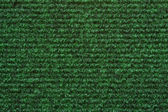 A green carpet texture — Stock Photo