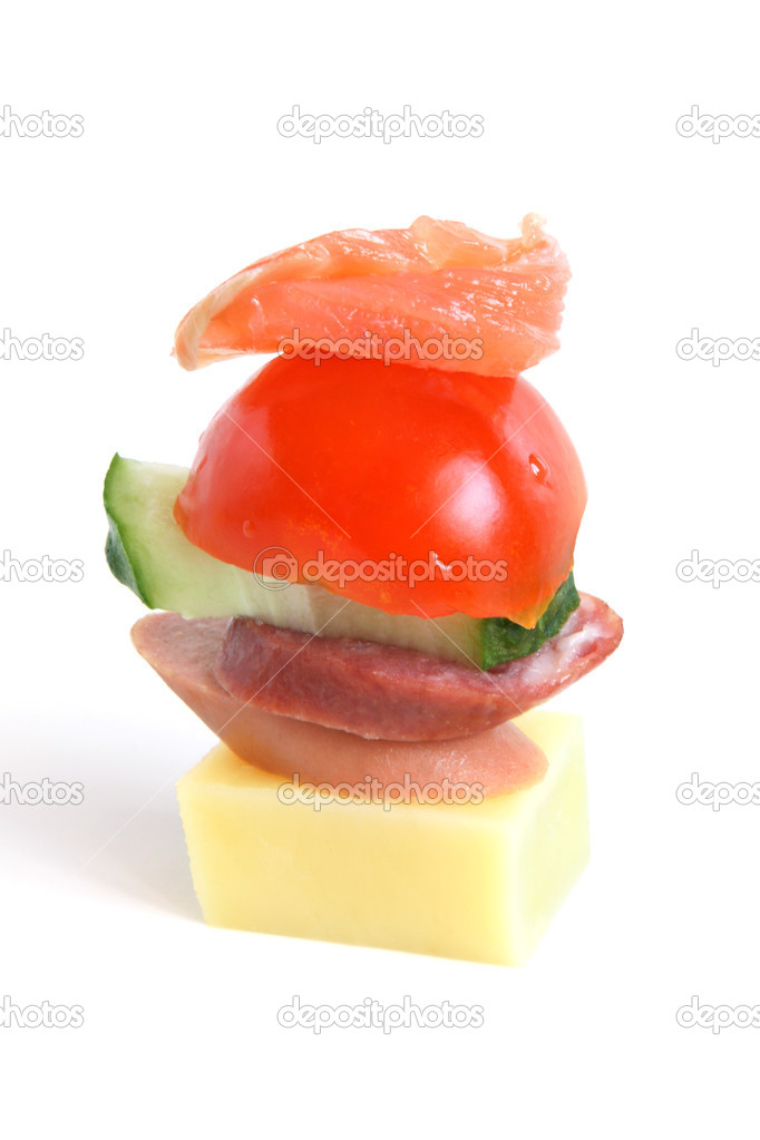 Stack of vegetables, sausages, fish and cheese on a white background — Stock Photo #2997391