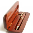 Mahogany ball pen in opened wooden case — Stock Photo