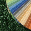 Stock Photo: Samples of collection multicolored linoleum on carpet backgr