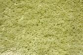 A green carpet texture — Stock Photo