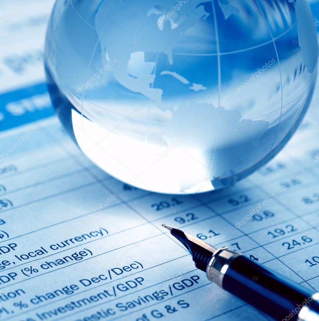 Glass globe and fountain pen on financial report — Stock Photo #3696482