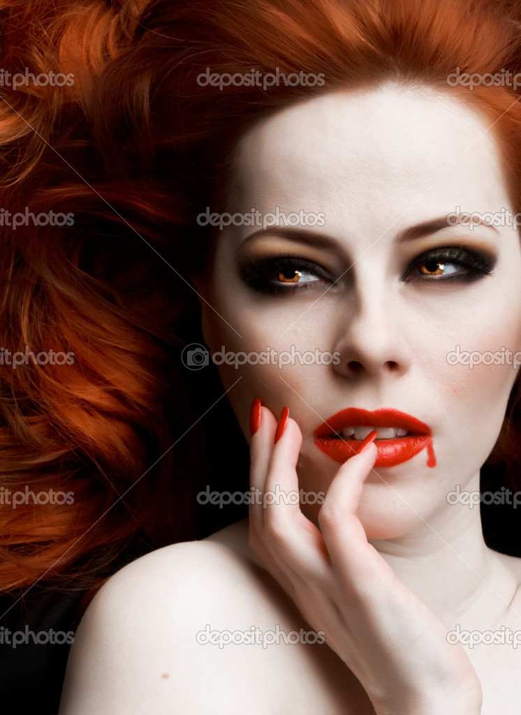 Closeup portrait of beautiful redhead vampire woman — Photo #2896670