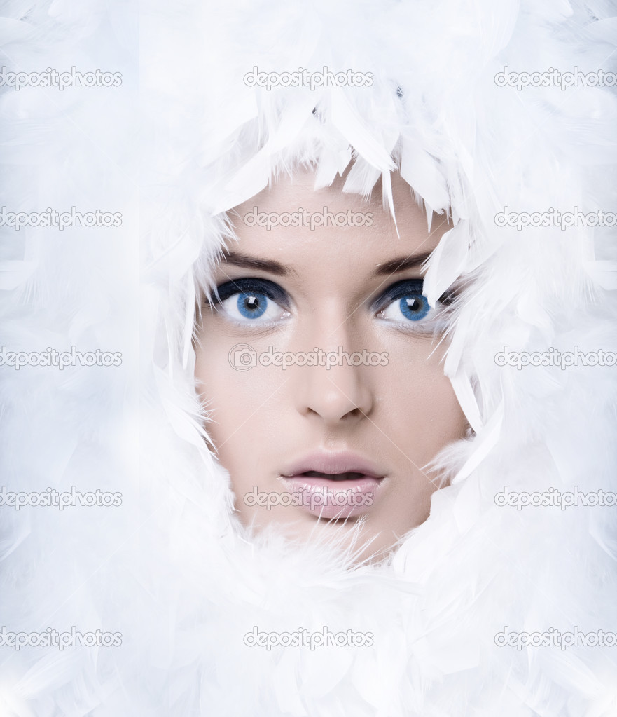 Closeup portrait of beautiful girl witk white feathers  Stock Photo #3770459