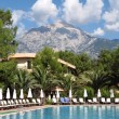 Turkey, Tekirova, mount Tahtali and swimming pool - Stock Photo