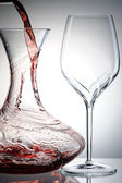 Pouring wine into decanter — Stock Photo