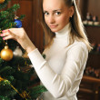 Decorating christmas tree — Stock Photo #2890888