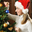 Decorating christmas tree — Stock Photo #2890906