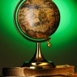 Antique globe on books — Stock Photo