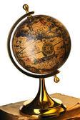 Antique globe on books — Stock Photo