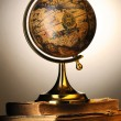 Antique globe on books — Stock Photo #3239861