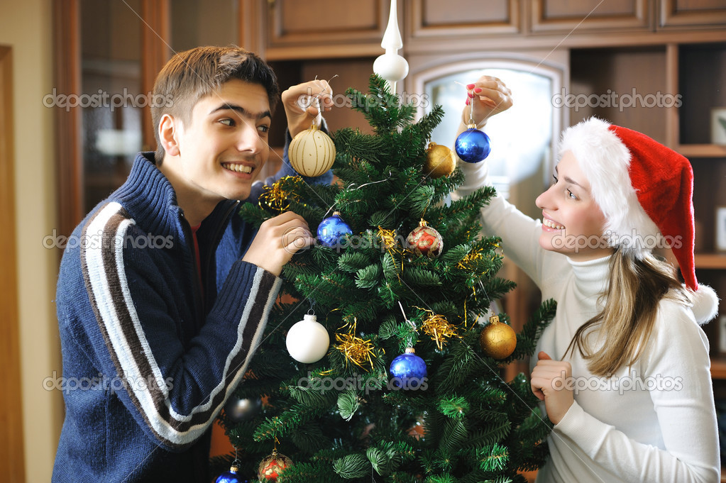 Young couple decorating christmas tree  Stock Photo #3239923