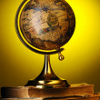 Stock Photo: Antique globe on books