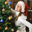 Decorating christmas tree — Stock Photo #3380560