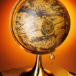 Antique globe on books — Stock Photo #3443449