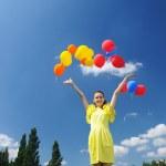 Releasing balloons — Stock Photo #3478774