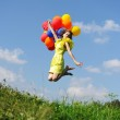 Flying with balloons — Stock Photo #3503447