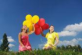 Meisjes met ballonnen — Stockfoto