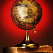 Antique globe on books - Stock Photo