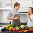 Couple cooking - Stock Photo