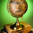 Antique globe on books — Stock Photo #3898655
