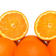 Two half-cut oranges isolated on white — Stock Photo
