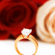 Engagement ring and roses — Stok fotoğraf
