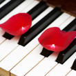Romantic concept - rose petals on piano — Stok fotoğraf