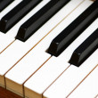 White and black keys of piano — Stock Photo