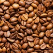 Close up of freshly roasted coffee beans - Stock Photo
