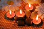 Aromatic candles and pebbles — Stock Photo