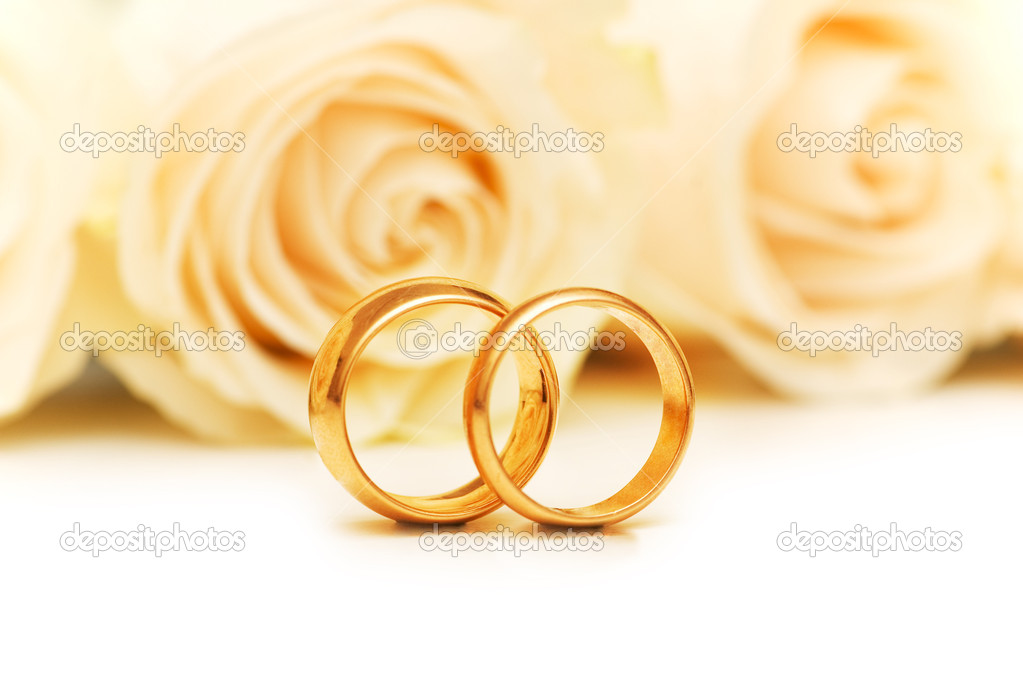 Roses and wedding rings isolated on the white  Stock Photo #2694907