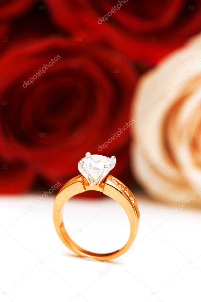 Engagement ring and roses at the background — Foto Stock #2694909