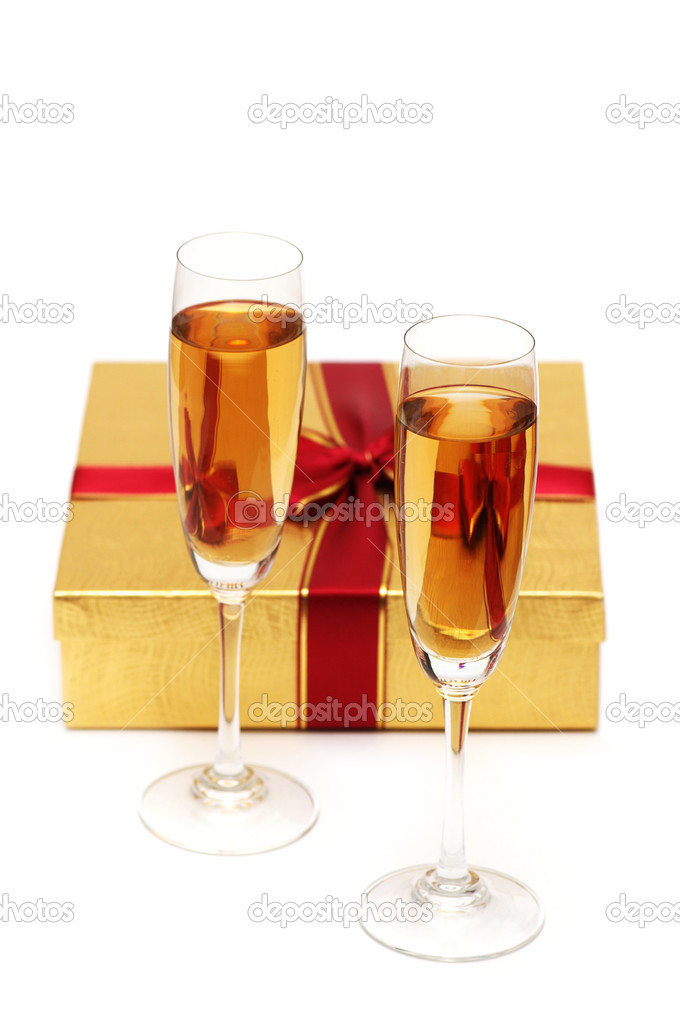 Glasses of champagne and gift on white — Stock Photo #2696720