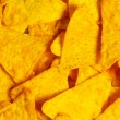 Royalty-Free Stock Photo: Heap of chips arranged on background