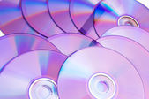 Many DVD's arranged at the white — Stock Photo