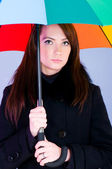 Portrait of young woman with umbrella — Stock Photo