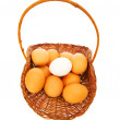 Stock Photo: Basket full of eggs isolated on white