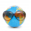 Royalty-Free Stock Photo: Globe with sunglasses isolated