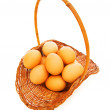 Basket full of eggs isolated on white — Stock Photo #2872850