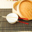 Stock Photo: Chopsticks and bowl on mat