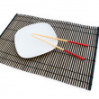 Stock Photo: Chopsticks and plate on mat