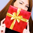 Young woman with red gift box — Stock Photo #2875560