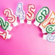 Birthday candles against  background — Stock Photo