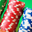 Stack of casino chips against gradient — Stock Photo