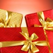 Gift box against gradient - Stock Photo