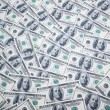 Stack of dollars on money background — Stock Photo #2876133