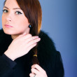 Portrait of a young woman wearing coat — Stock Photo #2876320