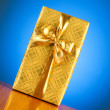 Gift box against gradient — Stock Photo #2876797