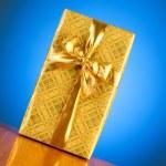 Gift box against gradient — Stock Photo